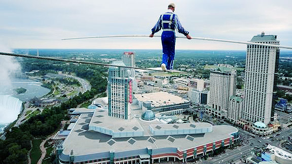 a tightrope walker going a long distance between two skyscrapers