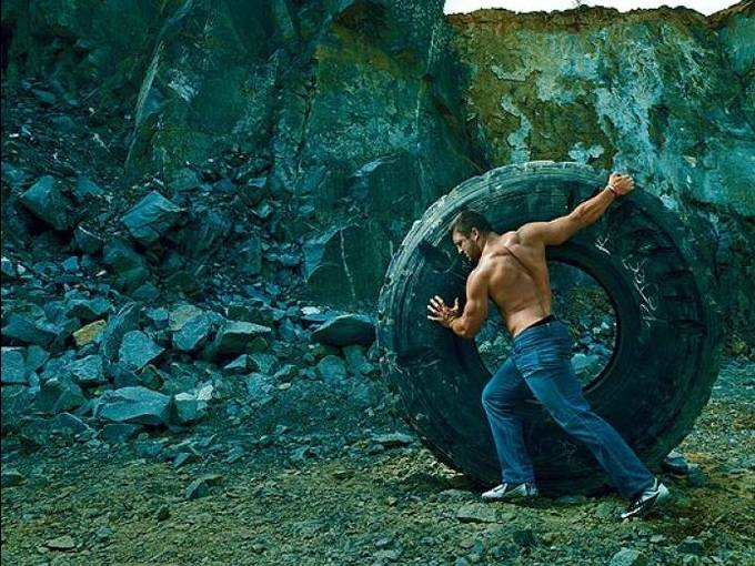 tim tebow rolling a giant tire