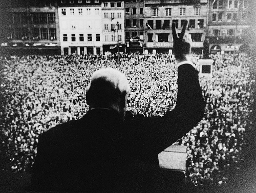 """Winston Churchill gives an adoring crowd the """"V"""" for victory sign"""