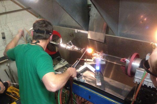 american worker making glass bongs