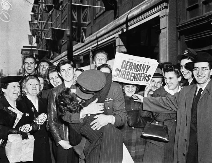 Soldier kissing girl on VE Day