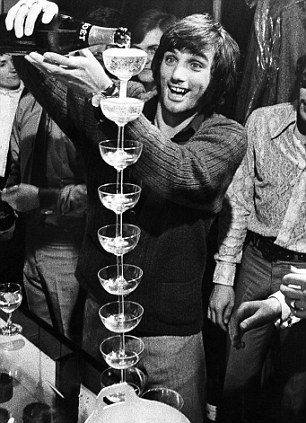 George Best pouring champagne onto stacked glasses