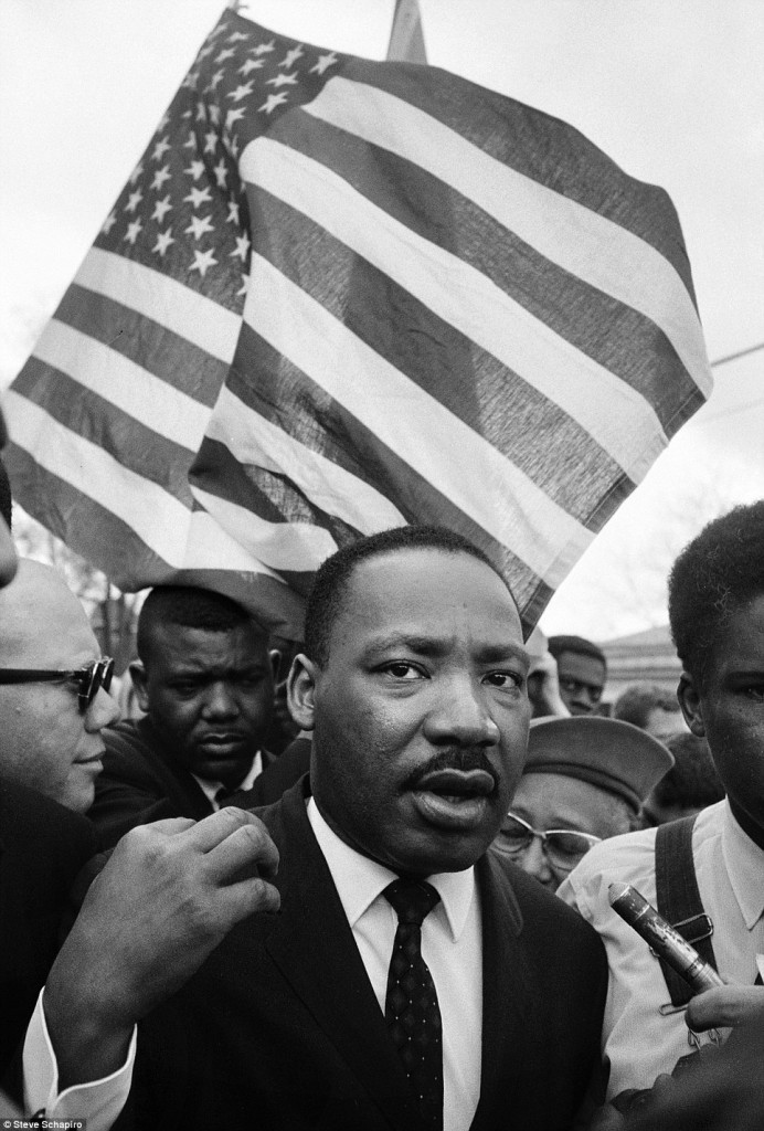 martin luther king in front of a huge American flag