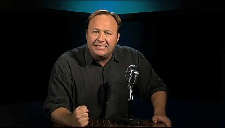 Conspiracy theorist Alex Jones pounds a table intensely