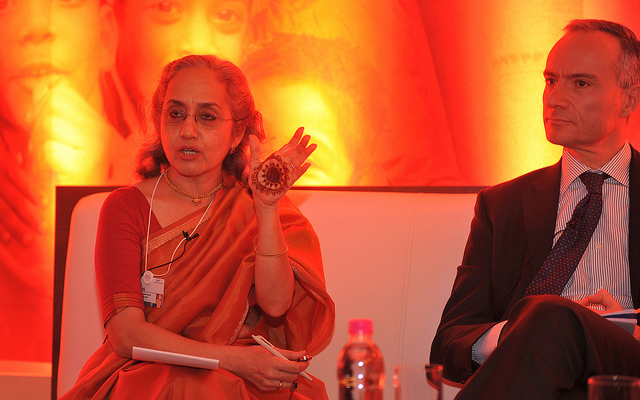 woman at indian economic summit showing cryptic drawing on her palm