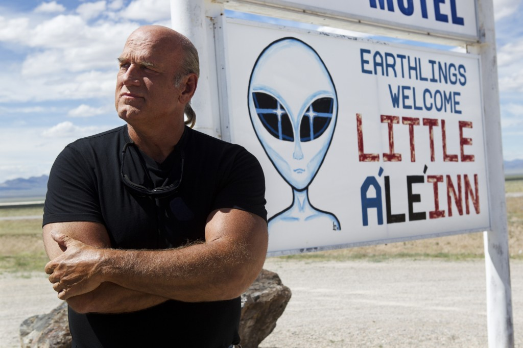 Governor Jesse Ventura in front of Alien billboard near Area 51