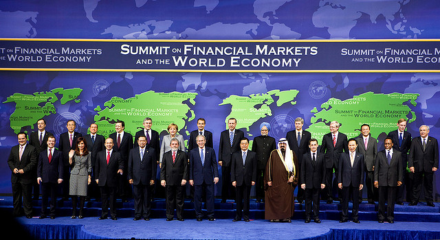 world economic leaders including George W. Bush pose at a summit of financial markets and the world economy