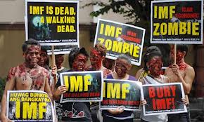 Protestors dressed as zombies protest the International Monetary Fund
