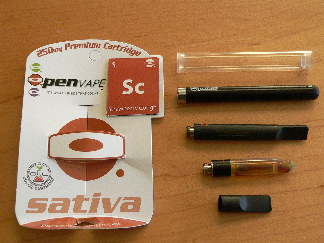 The O.Pen personal vaporizer and a Strawberry Cough vape cartridge.