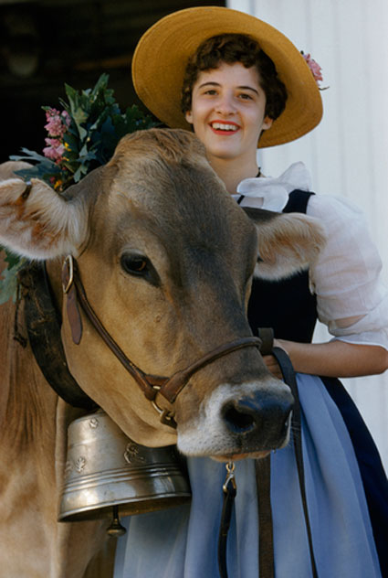 old fashoned milkmaid with prize cow