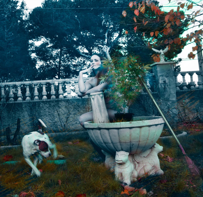 Woman with dog and pot plant in garden