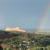 a rainbow next to garden of the gods